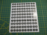 100 Klebezahlen ab 8 mm  hoch, Druck auf schwarz Arial weiß runde Kontur